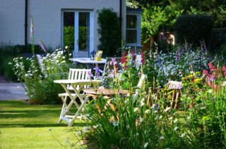 First opening for the Hordle Gardening Club. Chairs, tables and cake at the ready. | NGS Garden Ferns Lodge